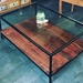 Mesa de centro de vidrio, fierro y madera