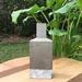 Esculturas de hormigón - escultura de hormigon con forma de botella pequeña.jpeg