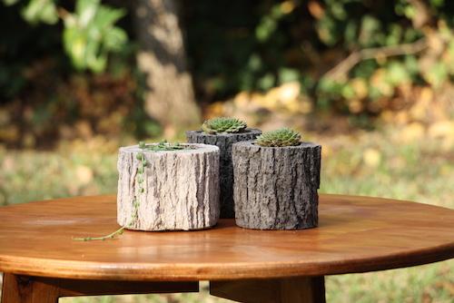 Macetero mediano de concreto tipo tronco