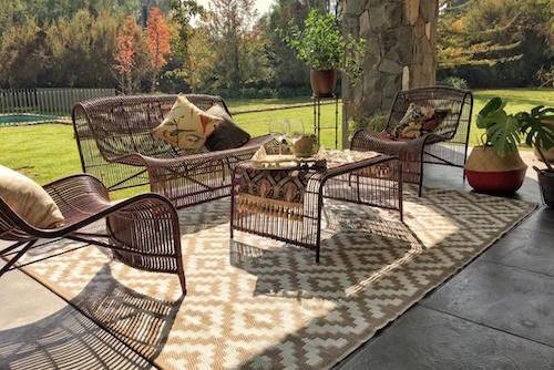 Terraza con juego Carpintero y alfombra de 180 x 270 cm