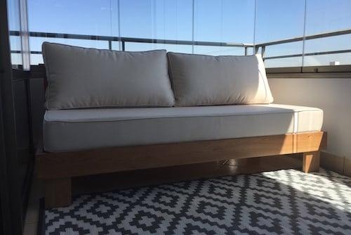 Sofá modular de mañío - sofa de dos cuerpos de mañio con cojines a medida.jpg