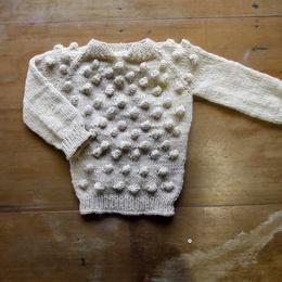 Chomba niño de lana de oveja tejida a palillos